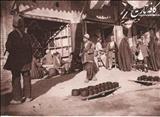 تصویری از مغازه لوستر فروشی در ایران قدیم